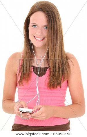 schöne vierzehn Jahre alt Teen Musik hören. in schuß weiß.