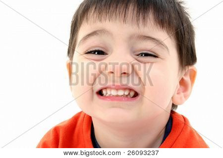 Close up of toddler boy smiling. Wearing orange casual shirt. Shot in studio over white.