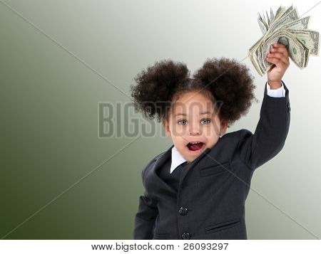 Beautiful Little Business Woman  And Money Over Green Background.  Shot in studio.