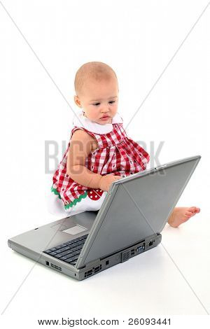 "Baby Girl With Laptop Computer Over White. Child has ""stork bite"" birthmark on upper lip. Shot in studio over white."