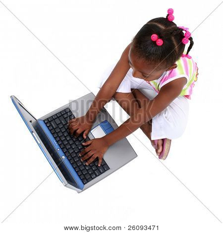 African American school child sitting on floor with laptop computer.