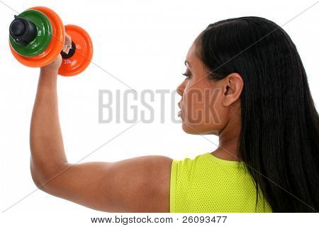 Beautiful woman in sports outfit working biceps with colorful dumbells.