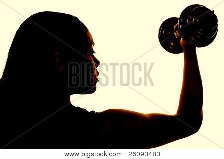 """Beautiful """"African American"""" woman in sports outfit working biceps with colorful dumbells."""