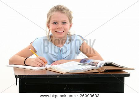 Beautiful Young Girl Sitting at School Desk. Shot in studio over white.