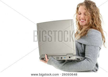 Sixteen year old teen with long curly blonde hair wearing grey sweater.  Holding laptop over white background.