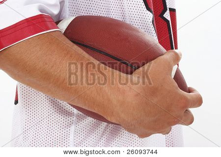 Close Crop of Man in Jersey Holding Football against a white background. Shot in studio.