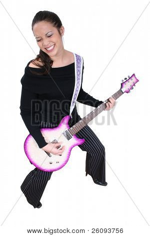 Beautiful Asian American woman playing electric guitar. Shot in studio over white.
