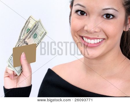 Woman with a gold ATM card (blank) and twenties.