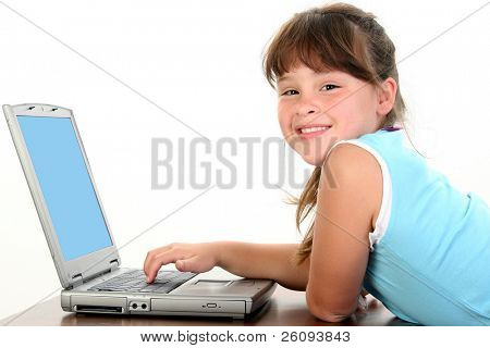 Adorable little girl working on laptop computer. Shot in studio over white.