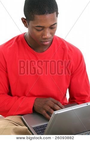 Casual man in red shirt working on laptop.  Shot in studio over white.