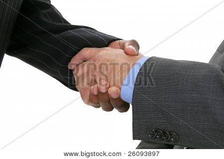 Close-up of businessmen in suits shaking hands.  Shot in studio over white.