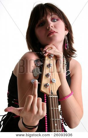 Beautiful Sixteen year old girl sitting with bass, shooting the finger towards camera.