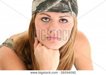 Beautiful young woman in camo rag and tank.  Shot in studio over white.  Stunning eyes and perfect skin.