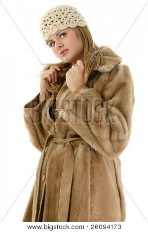 Beautiful young woman in tan hat and winter coat. Shot in studio over white.