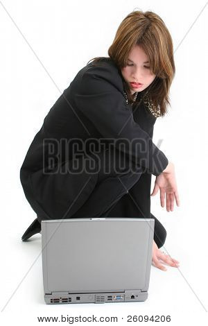 Beautiful Young Hispanic Woman with Laptop Computer. Wearing black business suit.  Shot in studio over white.