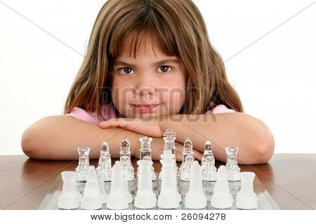 Beautiful little girl looking up from behind a glass chess board. Shot in studio over white.