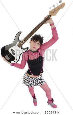 Beautiful young woman in pink and black with a 4 string bass electric.  Shot in studio over white. Full body standing with bass over head.
