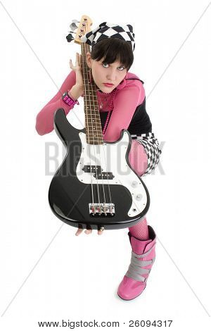 Beautiful young woman in pink and black with a 4 string bass electric.  Shot in studio over white.