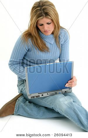 Beautiful Young Woman With Laptop.  Sitting on floor. Shot over white.
