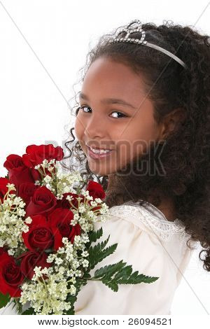 Beautiful six year old girl in pageant dress wearing tiara and holding bouquet of red roses.