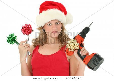 Beautiful young woman holding up tools with bows on them. Wearing santa hat and red tank top.  Shot over white.