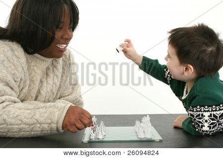 Beautiful African American Woman and two year old boy playing chess together.