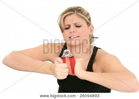 Weak young woman struggling with handgrip exerciser.