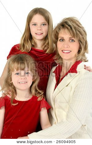 Smiling portrait of a mother and her daughters.