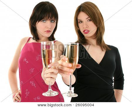 Two beautiful young woman (caucasian and hispanic)  in party dresses holding out classes of champagne.