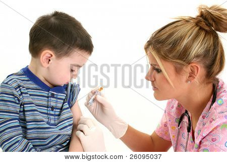 Small boy watching as nurse gives him a shot.