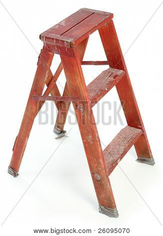 Nasty old red wooden ladder covered in paint, dirt and tape.  Shot over white.
