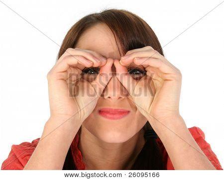Pretty young woman making Hand Binoculars. Shot in studio over white.