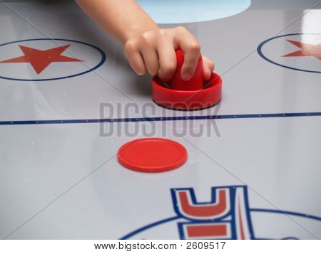 Hand On A Red Mallet On An Air Hockey Table