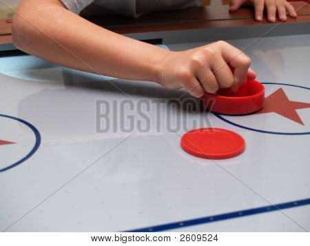 A Red Mallet And Disc On An Air Hockey Table