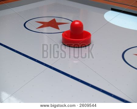 A Red Mallet On An Air Hockey Table