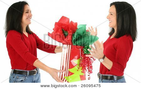 Conceptual image, giving your self a gift.  Attractive woman handing herself a present.