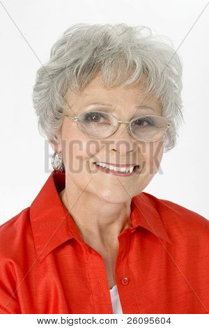 Beautiful older woman in glasses and red shirt over white.