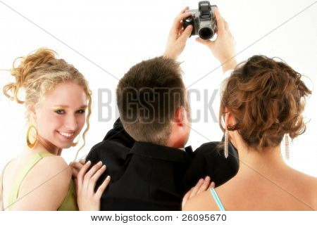Man taking photo of himself and two beautiful women. Dressed in formals. Shot in studio over white.