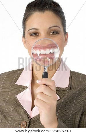 Beautiful Hispanic business woman with magnifying glass in front of mouth.  Created in camera... not photoshop.  Shot in studio over white.