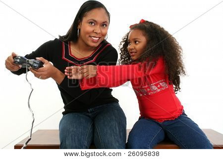 Mother and daughter fighting over game controller.