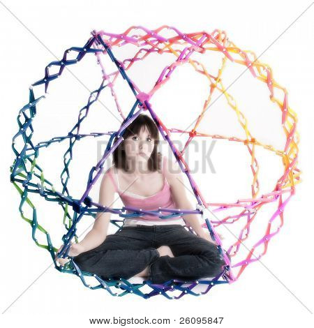 Attractive autistic teen girl inside collapsible rainbow colored ball.