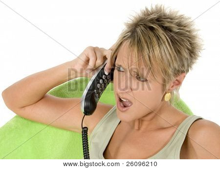 Woman angry with phone caller.