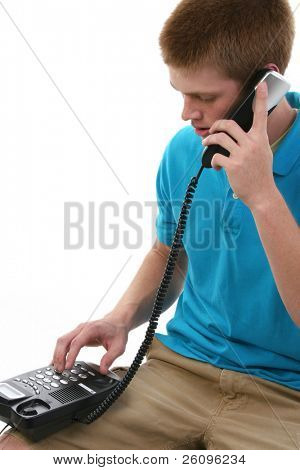 Sixteen year old teen boy making phone call.