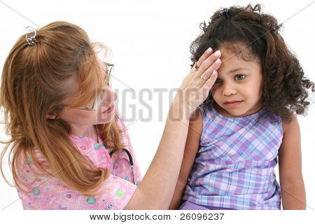 Nurse feeling sick young girl's forehead.