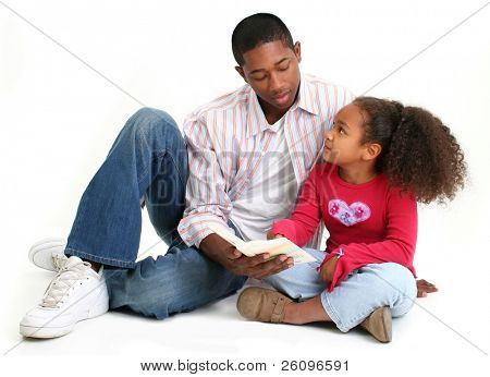 African American father and daughter reading child's bible