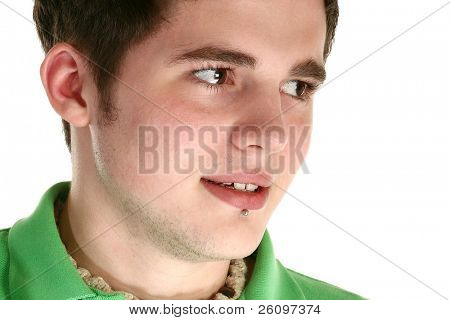 Attractive young man with Labret Piercing over white.