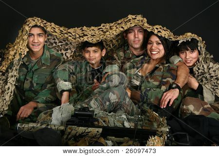 Attractive Caucasian Filipino mixed family in camo fatigues and hunting gear.