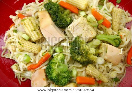 Plate of chicken stirfry with noodles and veggies.