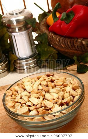 Unsalted dry roasted peanuts in a bowl in kitchen or restaurant.