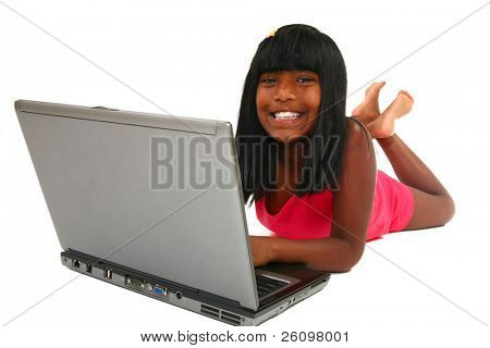 Beautiful 10 year old Indian girl on laptop.